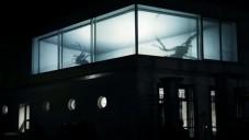 Obří pavouci promítáni na budovu jako videomapping